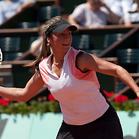 31 May 2009: Aravane Rezai of France eyes the ball as she prepares a forehand during the Women's Singles fourth round match on day eight of the French Open at Roland Garros in Paris, France.