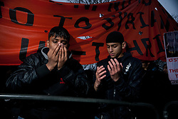 © licensed to London News Pictures. London, UK 18/02/2012. Two protesters are praying outside Syrian Embassy in London, after Islamist group Hizbut Tahrir marched to Syrian Embassy in London to protest against Bashar al Assad's regime. Photo credit: Tolga Akmen/LNP