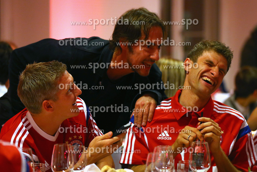 17.05.2014, T Com, Berlin, GER, DFB Pokal, Bayern Muenchen Pokalfeier, im Bild Bastian Schweinsteiger (L) of Bayern Muenchen celebrates with his team mate Thomas Mueller (R) and Thomas Hayo Bastian Schweinsteiger, Thomas Mueller, Thomas Hayo, // during the FC Bayern Munich &quot;DFB Pokal&quot; Championsparty at the T Com in Berlin, Germany on 2014/05/17. EXPA Pictures &copy; 2014, PhotoCredit: EXPA/ Eibner-Pressefoto/ EIBNER<br /> <br /> *****ATTENTION - OUT of GER*****