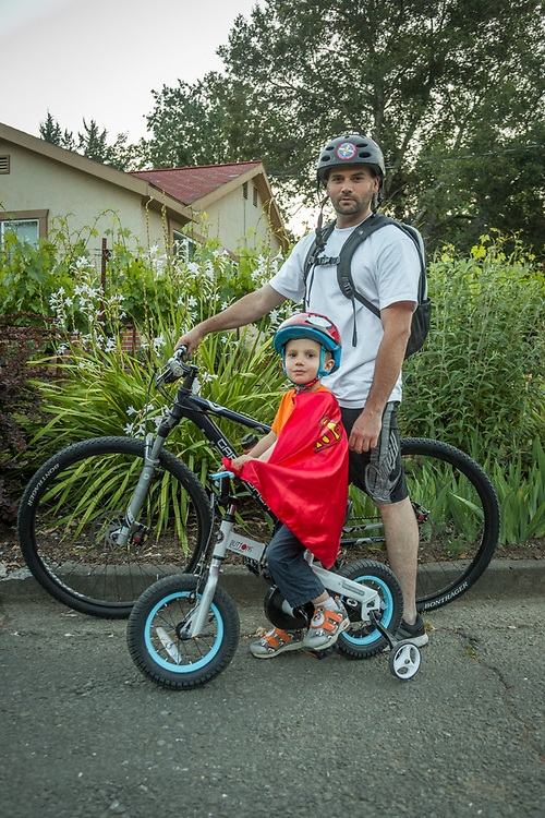 Wine advisor Cory Johnston with his three year old son, Jaxson, take an after dinner bike ride