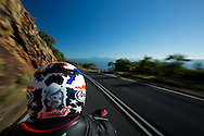 Riding Along the Captain Cook Highway Between Cairns And Port Douglas. Cairns, Queensland, Australia. 03/06/2012. Photo By Lucas Wroe.