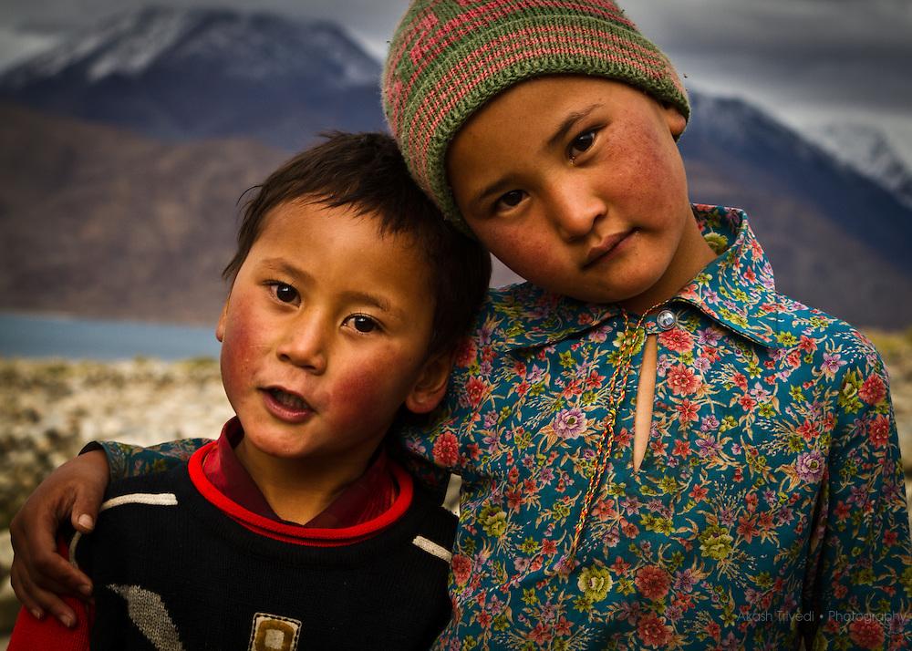 Children posing for the camera. Pangong  Tso, India.