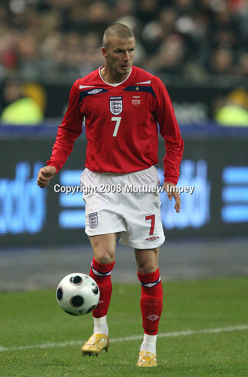 David Beckham of England in action during the game of his 100th cap. France v England, International Friendly, Football, Stade de France, Paris, 26/03/2008. © Matthew Impey / Wiredphotos.co.uk. tel: 07789 130 347 e: matt@wiredphotos.co.uk