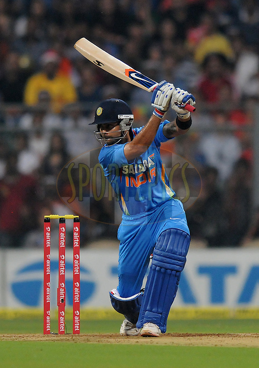 Virat Kohli of India bats during the 2nd Airtel T20 Match between India and England held at The Wankhede Stadium in Mumbai on the 22nd December 2012..Photo by Pal PIllai/BCCI/SPORTZPICS ..Use of this image is subject to the terms and conditions as outlined by the BCCI. These terms can be found by following this link:..http://www.sportzpics.co.za/image/I0000SoRagM2cIEc