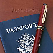 Travel Memories. Still-life of a Journal, Passport and Pen.