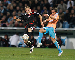 MARSEILLE, FRANCE - Tuesday, December 11, 2007: Liverpool's Fabio Aurelio and Olympique de Marseille's Laurent Bonnart during the final UEFA Champions League Group A match at the Stade Velodrome. (Photo by David Rawcliffe/Propaganda)