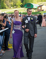 Taylor Sullivan and Griffin Nyhan march through the crowd gathered at Gunstock for Laconia High School's Junior Prom Friday evening.  (Karen Bobotas/for the Laconia Daily Sun)
