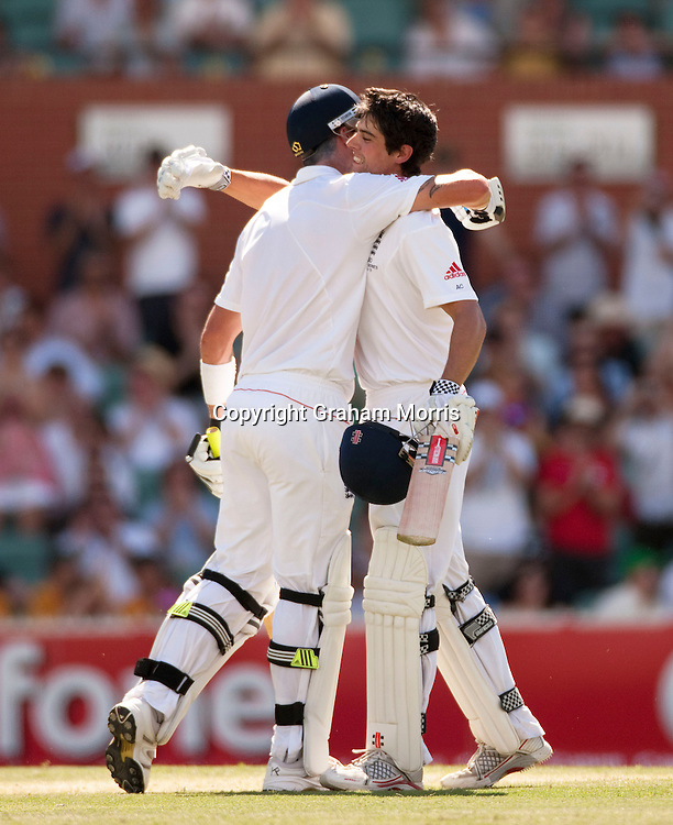 Alastair Cook celebrates his century (with Kevin Pietersen) in the second Ashes Test Match between Australia and England at the Adelaide Oval. Photo: Graham Morris (Tel: +44(0)20 8969 4192 Email: sales@cricketpix.com) 4/12/10