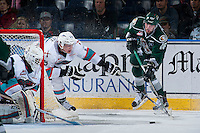 KELOWNA, CANADA - JANUARY 08: Cal Foote #25 of Kelowna Rockets stick checks Carson Stadnyk #16 of Everett Silvertips as he passes the puck on January 8, 2016 at Prospera Place in Kelowna, British Columbia, Canada.  (Photo by Marissa Baecker/Shoot the Breeze)  *** Local Caption *** Cal Foote; Cole MacDonald;