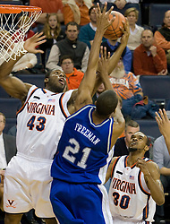Virginia guard/forward Will Harris (43) grabs a rebound from Hampton Pirates guard Michael Freeman (21).  The Virginia Cavaliers men's basketball team defeated the Hampton Pirates 79-65 at the John Paul Jones Arena in Charlottesville, VA on December 19, 2007.