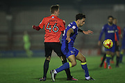 AFC Wimbledon defender Will Nightingale (5) and Brighton & Hove Albion striker James Tilley (46) during the EFL Trophy match between AFC Wimbledon and U23 Brighton and Hove Albion at the Cherry Red Records Stadium, Kingston, England on 6 December 2016.