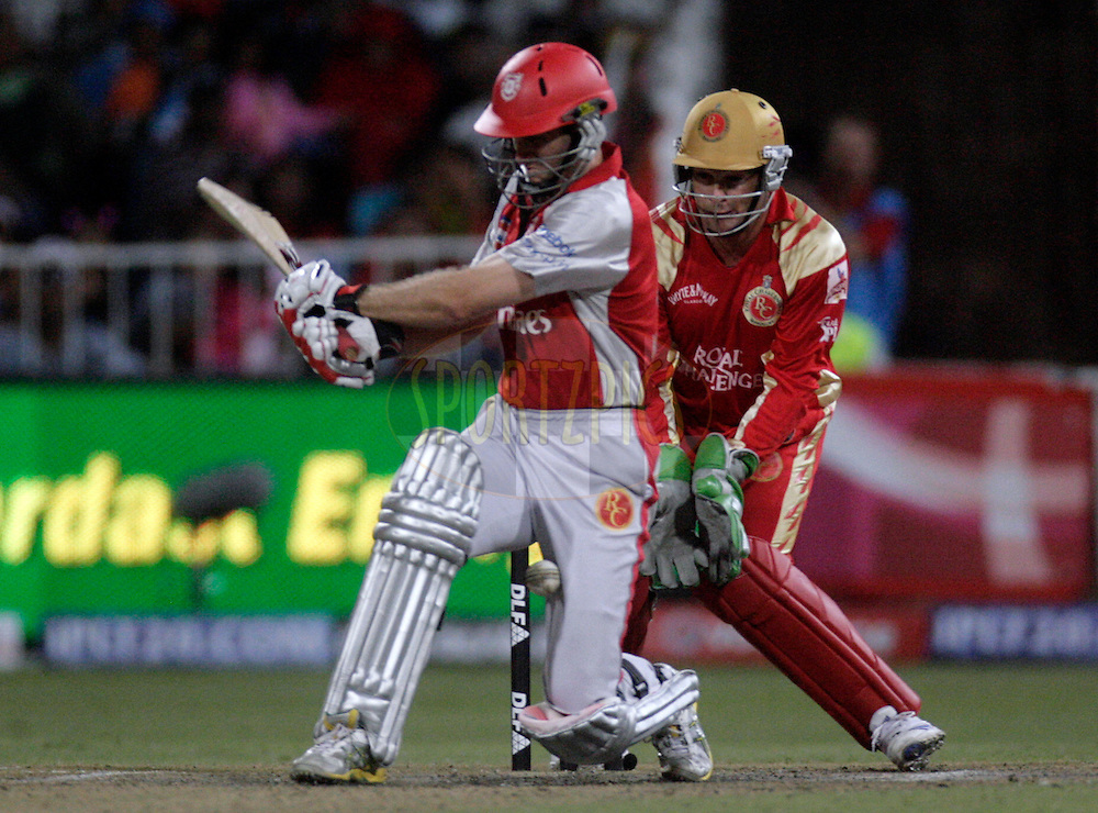 DURBAN, SOUTH AFRICA - 1 May 2009. Simon Katich plays a shot with Mark Boucher looking on during the IPL Season 2 match between Kings X1 Punjab and the Royal Challengers Bangalore held at Sahara Stadium Kingsmead, Durban, South Africa...