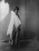 North American Native Atsina woman, full-length photographic portrait.