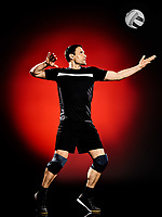 one caucasian volley ball player man isolated on colorful black background