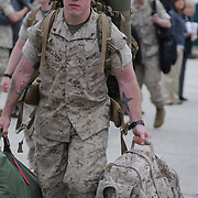 5/5/11 -- TOPSHAM, Maine.  U.S. Marine Reservists departed from Topsham on Thursday for the start of a year-long deployment to Afghanistan amidst a crowd of family, friends and well-wishers. This mission will be different from others, said several Marines, because instead of doing combat operations they will be teaching the Afghan National Army to operate independently. They travel first to California for several months of training and are planning to return in May 2012. Photo by Roger S. Duncan.
