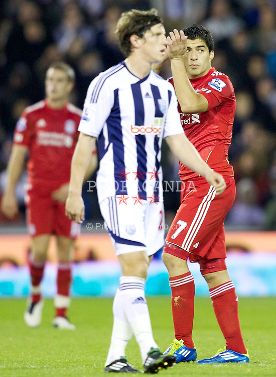 WEST BROMWICH, ENGLAND - Saturday, October 29, 2011: Liverpool's Luis Alberto Suarez Diaz goes off the pitch during the Premiership match against West Bromwich Albion at The Hawthorns. (Pic by Vegard Grott/Propaganda)