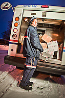 Letter carrier, Queen Stewart, handles holiday packages for delivery in South Addition, Anchorage
