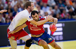 Henrik Toft Hansen of Denmark vs Ivan Stankovic of Serbia during final handball match between Serbia and Denmark at 10th EHF European Handball Championship Serbia 2012, on January 29, 2012 in Beogradska Arena, Belgrade, Serbia.  (Photo By Vid Ponikvar / Sportida.com)