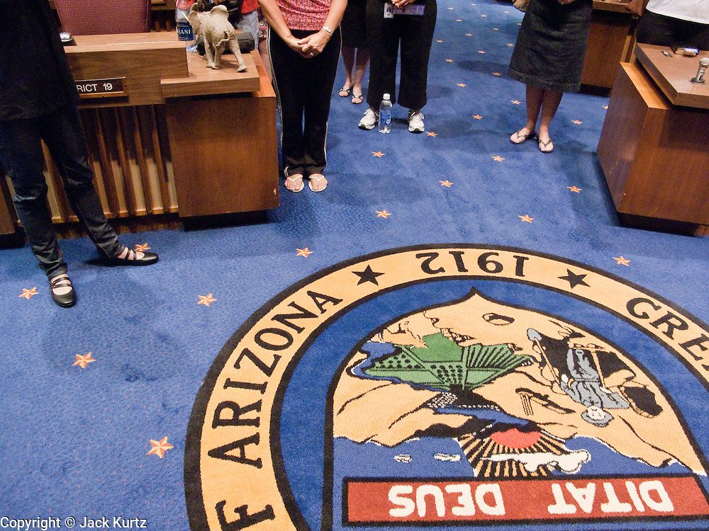 07 MAY 2009 -- PHOENIX, AZ: People gather around the state seal in the Senate chambers during the National Day or Prayer services at the State Capitol in Phoenix Thursday. About 30 people came to the capitol to pray for government officials at the desks of legislators.   Photo by Jack Kurtz