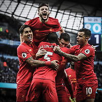 James Milner of Liverpool celebrates scoring the 1st goal during the Premier League match between Manchester City and Liverpool played at the Etihad Stadium, Manchester on 19th March 2017