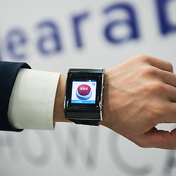 London, UK - 17 March 2014:  a SOS app on the XS-3 Android Smart watch-phone by Exetech at the Wearable Technology Conference at Olympia in London