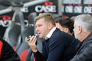 Milton Keynes Dons manager Karl Robinson on the phone in the dugout  during the EFL Sky Bet League 1 match between Milton Keynes Dons and Port Vale at stadium:mk, Milton Keynes, England on 9 October 2016. Photo by Dennis Goodwin.