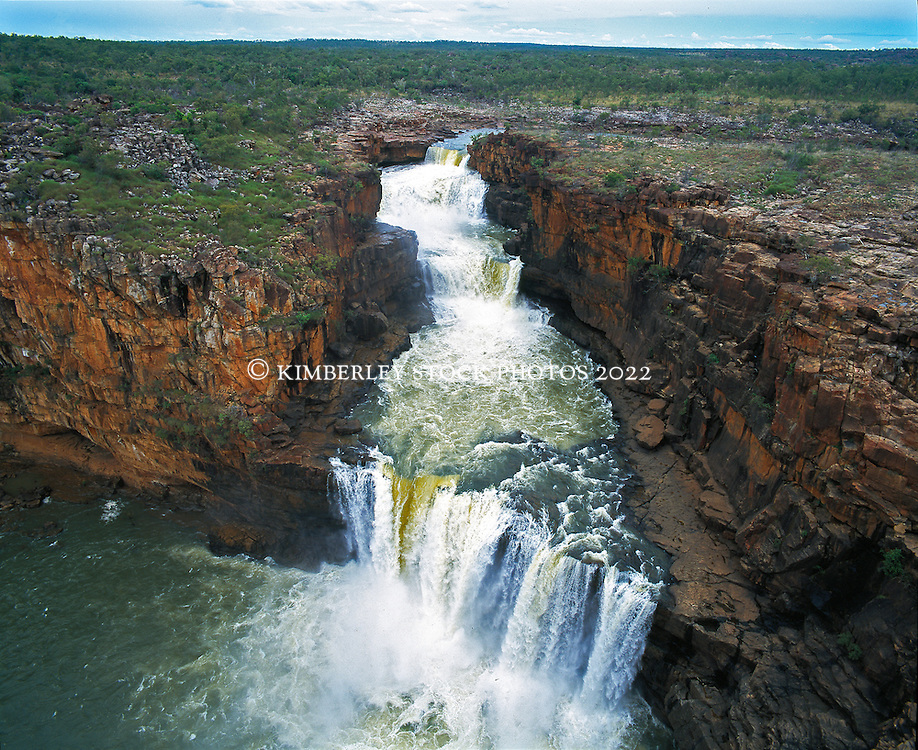 Water pours over Mitchell Falls in the Kimberley wet season.