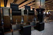 Long-term shoe-shine franchise owner Dudley masters awaits more business at Heathrow's Terminal 5.