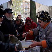 DONETSK, UKRAINE - OCTOBER 18, 2014: A group of volunteers distribute food to people in need in central Donetsk. Some groups have, in the past few months, been providing food and clothing to an increasingly number of people directly affected by the war in the eastern regions of Ukraine. CREDIT: Paulo Nunes dos Santos
