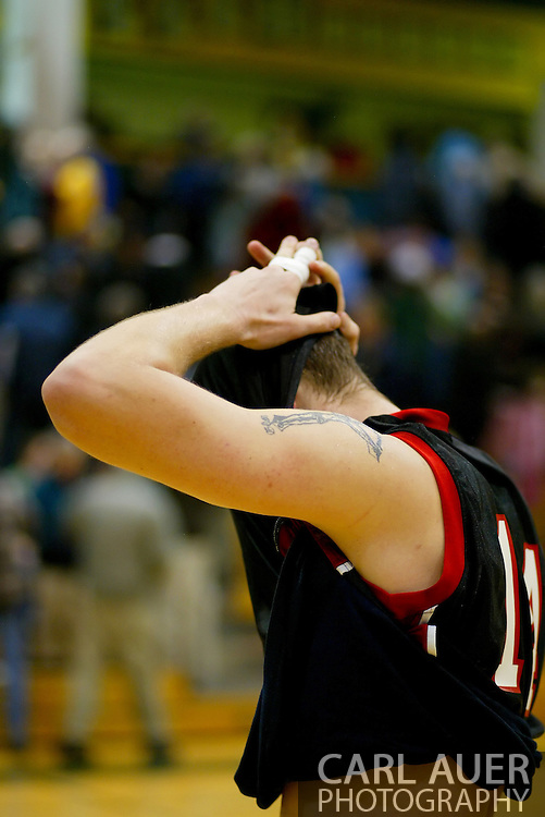 1/13/2006: Casey Fisher of the Northwest Nazarene University Crusaders reacts to giving up a lead and eventually loosing to Alaska Anchorage in UAA's comeback victory over Northwest Nazarene, 60-57, in men?s basketball action at the Wells Fargo Sports Complex on Saturday.