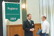 "Associate University Registrar Patrick Beatty (Left) talks with the College of Arts and Sciences Dean Robert Frank at ""Your Passport to The OHIO Guarantee"". Photo by Ben Siegel/ Ohio University"