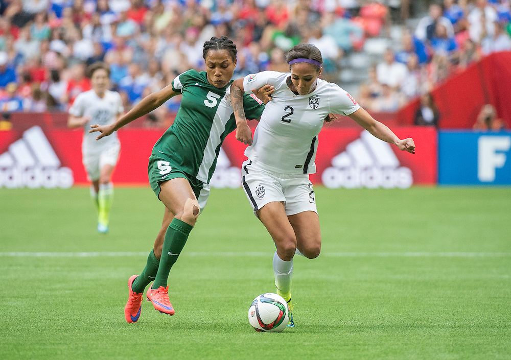 Onome Ebi of team Nigeria  (left) and Sydney Leroux of team USA in 2015 women's World Cup Soccer in Vancouver during the first round action between USA and Nigeria.