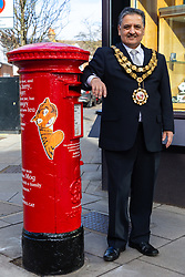 Mayor of Richmond upon Thames Cllr Ben Khosa poses next to a postbox on Barnes High Street that honours local resident and beloved children's author Judith Kerr as part of Royal Mail's initiative to promote Book Week.. Barnes, London, March 07 2019.