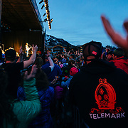 Micahel Franti and Spearhead perform to a packed crowd in Teton Village, Wyoming. Michael Franti on stage with surrounding crowd in Teton Village.