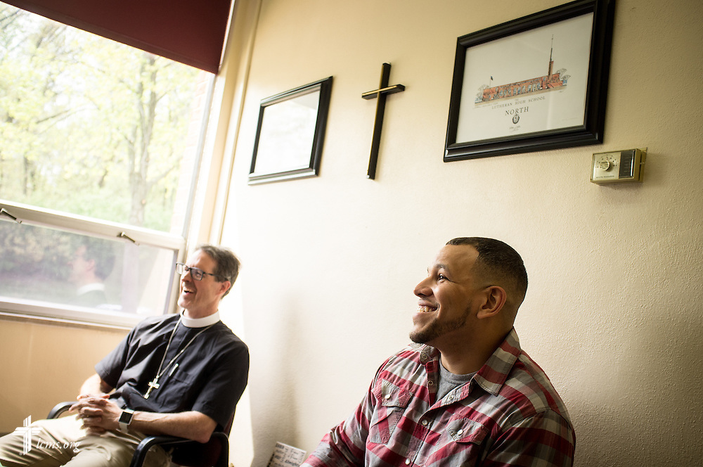 Micah Glenn, a fourth-year Master of Divinity student at Concordia Seminary, St. Louis and new national missionary to Ferguson, chats with Lutheran High School North Principal Tim Brackman (not pictured) during a visit to the school with the Rev. Steve Schave, director of LCMS Urban & Inner-City Mission (UICM) and director of LCMS Church Planting, at the school in St. Louis on Wednesday, April 20, 2016. LCMS Communications/Erik M. Lunsford
