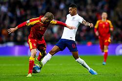 Marcus Rashford of England is tackled by Aleksandar Sofranac of Montenegro - Rogan/JMP - 14/11/2019 - FOOTBALL - Wembley Stadium - London, England - England v Montenegro - UEFA Euro 2020 Qualifiers.