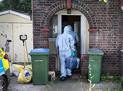 © Licensed to London News Pictures. 24/06/2018. London, UK. Police forensics officers enter a house in Greenwich after the body of a woman in her 50s was found in the back garden yesterday. Photo credit: Peter Macdiarmid/LNP