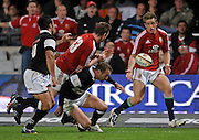 Brian O'Driscoll passes the ball to Luke Fitzgerald of the Lions for his try. Monty Dumond and Stefan Terblanche of the Sharks is to late to stop him.<br /> Rugby - 090610 - British&Irish Lions v Sharks - ABSA Stadium - Durban - South Africa. The Lions won 37 -3.<br /> Photographer : Anton de Villiers / SASPA