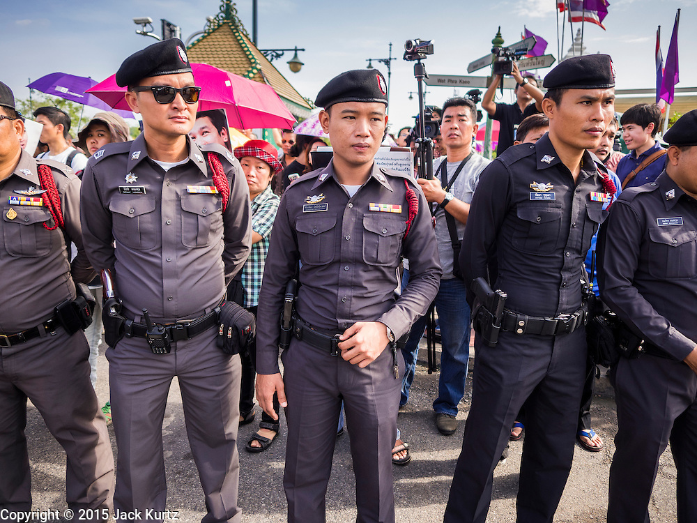 07 JULY 2015 - BANGKOK, THAILAND:  Thai police in front of the Ministry of Defense in Bangkok during a rally to support students arrested by the military. About 100 people gathered in front of the Ministry of Defense in Bangkok Tuesday to support 14 university students arrested two weeks ago for violating orders against political assembly. They're facing criminal trial in military courts. The courts ordered their release Tuesday because they can only be held for two weeks without trial, the two weeks expired Tuesday and the military court chose not to renew their pretrial detention. The court order was not an acquittal. They still face trial and possible prison sentences if convicted.       PHOTO BY JACK KURTZ
