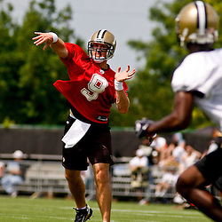 June 5, 2010; Metairie, LA, USA; New Orleans Saints quarterback Drew Brees (9) throws a pass to wide receiver Adrian Arrington (87) during a mini camp practice at the New Orleans Saints practice facility. Mandatory Credit: Derick E. Hingle