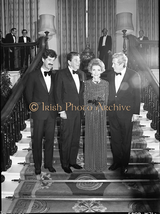 President Reagan Visits Ireland..(formal dinner)..1984.04.06.1984.06.04.1984.4th June 1984..The Banquet for President and Mrs Reagan was held in Dublin Castle,Dame St,Dublin..Portrait taken on the stairs of Dublin Castle, president and Mrs Reagan are flanked by (L) Tanaiste,Mr Dick Spring and the Taoiseach, Mr Garret Fitzgerald