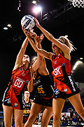 Sophia Fenwick of the Tactix and Jane Watson of the Tactix take the ball from Abigail Latu-Meafou of the Magic during the ANZ Premiership Netball match, Tactix v Magic, Horncastle Arena, Christchurch, New Zealand, 19th May 2019.Copyright photo: John Davidson / www.photosport.nz