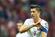 Warsaw, Poland - 2017 September 04: Robert Lewandowski from Poland checks his captain's armband during soccer match Poland v Kazakhstan - FIFA 2018 World Cup Qualifier at PGE National Stadium on September 04, 2017 in Warsaw, Poland.<br /> <br /> Adam Nurkiewicz declares that he has no rights to the image of people at the photographs of his authorship.<br /> <br /> Picture also available in RAW (NEF) or TIFF format on special request.<br /> <br /> Any editorial, commercial or promotional use requires written permission from the author of image.<br /> <br /> Mandatory credit:<br /> Photo by &copy; Adam Nurkiewicz / Mediasport
