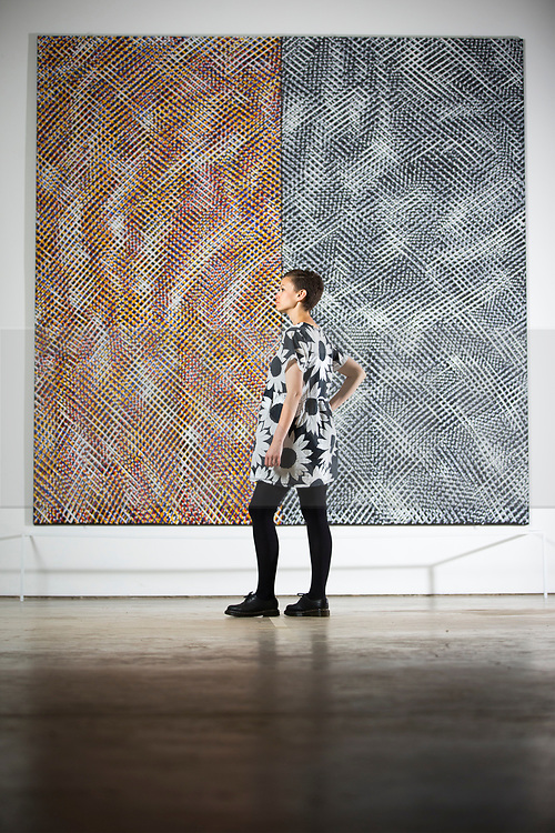 """© Licensed to London News Pictures. 14/07/2017. Wakefield UK. Kerry chase looks at the art piece Two Units, One Grey by artist Noel Foster which is part of the new exhibition """"Occasional Geometries"""" curated by Bangladeshi-born artist Rana Begum at the Yorkshire Sculpture park in Wakefield, the exhibition is largely selected from the Art's Council Collection & is designed to create an architectural, spatial & Playful experience through colour, movement & changing light.. The new exhibition is part of the Yorkshire Sculpture Parks 40th anniversary celebration """"A weekend of wonderful things"""" Photo credit: Andrew McCaren/LNP"""