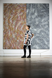 "© Licensed to London News Pictures. 14/07/2017. Wakefield UK. Kerry chase looks at the art piece Two Units, One Grey by artist Noel Foster which is part of the new exhibition ""Occasional Geometries"" curated by Bangladeshi-born artist Rana Begum at the Yorkshire Sculpture park in Wakefield, the exhibition is largely selected from the Art's Council Collection & is designed to create an architectural, spatial & Playful experience through colour, movement & changing light.. The new exhibition is part of the Yorkshire Sculpture Parks 40th anniversary celebration ""A weekend of wonderful things"" Photo credit: Andrew McCaren/LNP"