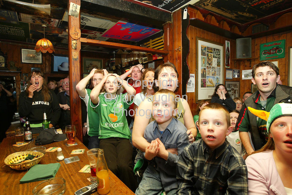 16/6/2002.Irish fans in Carrolls Bar in Thomastown County Kilkenny watch as Ireland go out of the World Cup beaten by Spain..Picture Dylan Vaughan