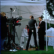 UK. London. From a story on Abingdon Street Gardens, a small patch of land, often referred to as College Green, that lies next to The Houses of Parliament in Westminster. It is a place where the media and the politicians come face to face. Interviews are held, photo shoots are set up and bewildered tourists stroll by..Photo shows Alastair Campbell, Tony Blair?s former Press Secretary talking to CNN about the resignation of Britain's prime Minister..Photo©Steve Forrest/Workers Photos