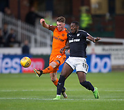 August 9th 2017, Dens Park, Dundee, Scotland; Scottish League Cup Second Round; Dundee versus Dundee United; Dundee United's Jamie Robson and Dundee's Roarie Deacon in a race for the ball