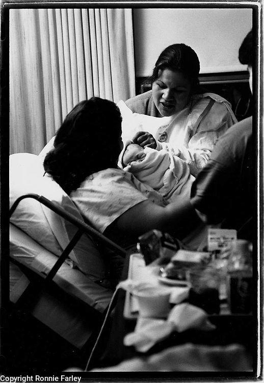 Mohawk midwife Katsi Cook tends to a birth at Massena memorial hospital in Massena, New York, 1992.