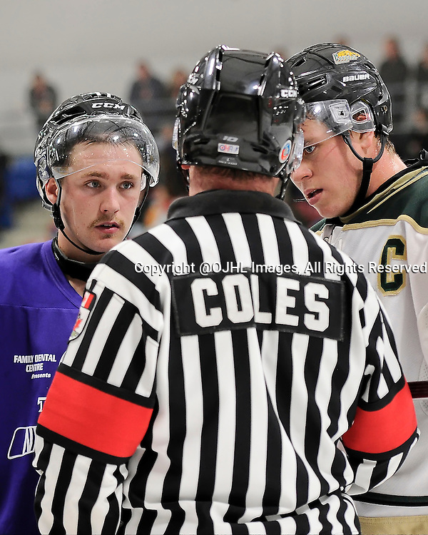 TRENTON, ON - Oct 17, 2014 : Ontario Junior Hockey League game action between Cobourg and Trenton, OHA Referee Coles speaks to Connor Armour #22 of the Cobourg Cougars and Tyler Donaldson #11 of the Trenton Golden Hawks about the penalty calls during the third period<br /> (Photo by Amy Deroche/ OJHL Images)
